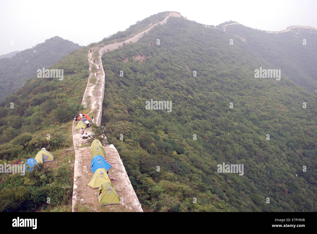 Western students camping on a remote part of the Great Wall, China 2014 - Stock Image