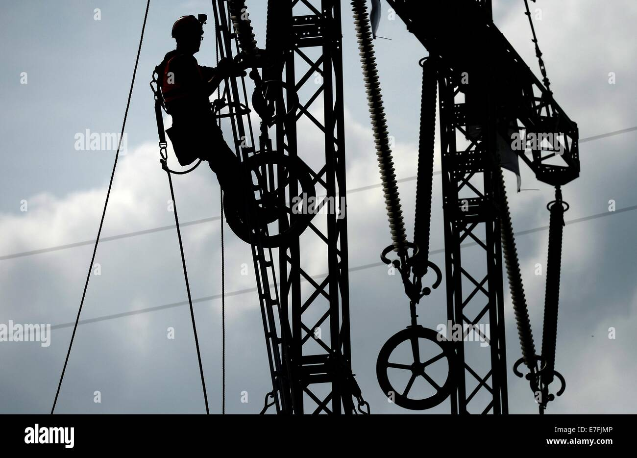 German and Czech firemen connect an emergency linkage duing an complex emergency exercise in an electricity power - Stock Image