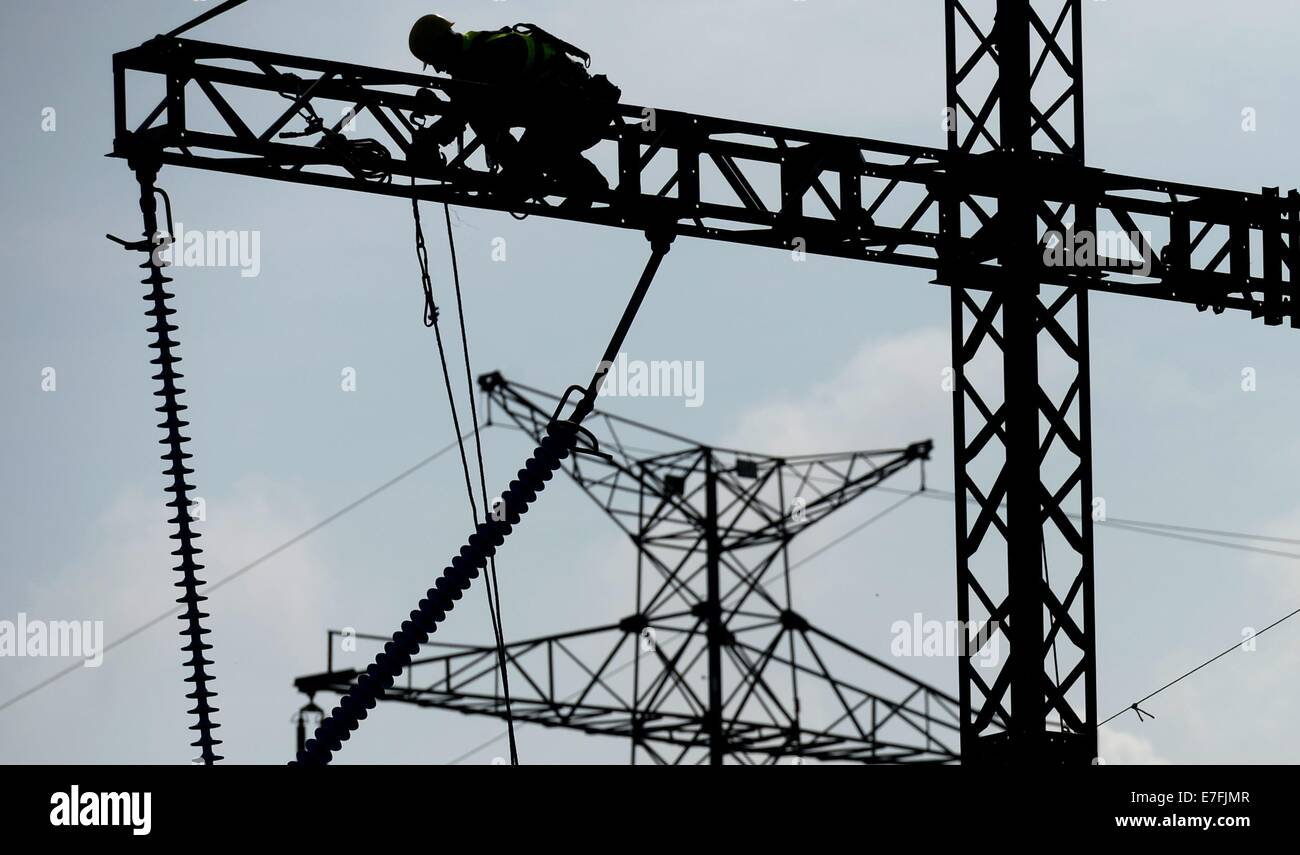 German and Czech firemen work to rescue people duing an complex emergency exercise in an electricity power line - Stock Image