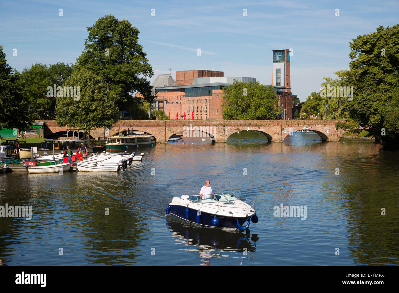 Boats on the River Avon and the Royal Shakespeare Theatre, Stratford-upon-Avon, Warwickshire, England, United Kingdom, - Stock Image