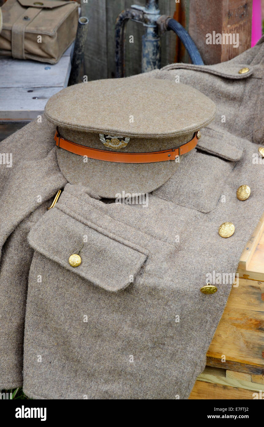 Dress jacket and cap of a WW1 British Army soldier laid on a packing case as poart of a military display Romsey - Stock Image