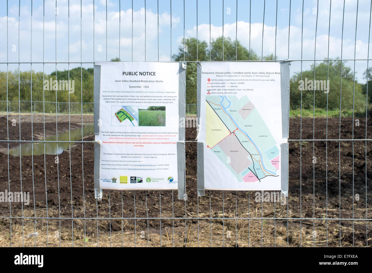 Public notice attached to wire fence outside of reed bed renovation project next to River Avon Salisbury Wiltshire - Stock Image
