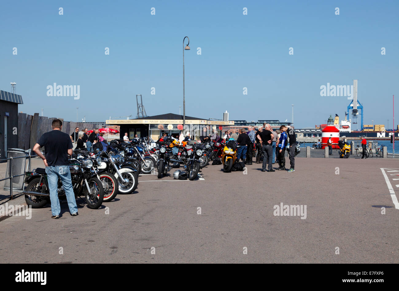 The popular ice-cream and fast food stall at the pier-head of theLangelinie pier in the port of Copenhagen. Bikers, - Stock Image