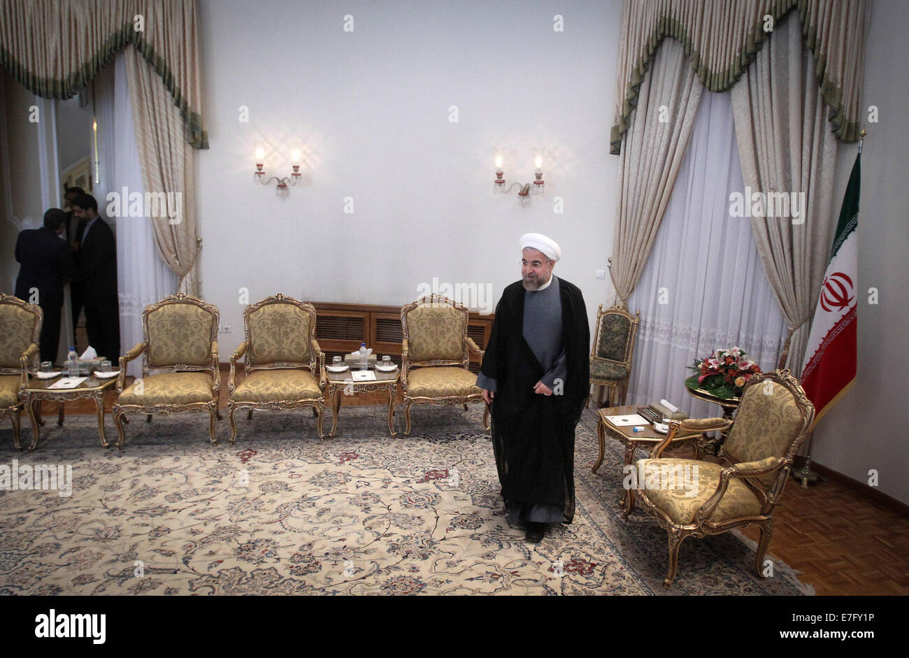 Tehran, Iran. 16th Sep, 2014. Iranian President Hassan Rouhani (R) waits for Ri Su Yong (not in the picture), Foreign Stock Photo