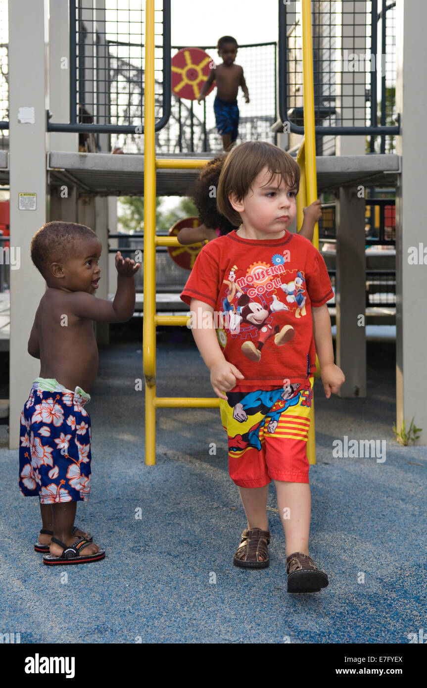 Toddlers Playing on Playground at Waterfront Park in Louisville Kentucky - Stock Image