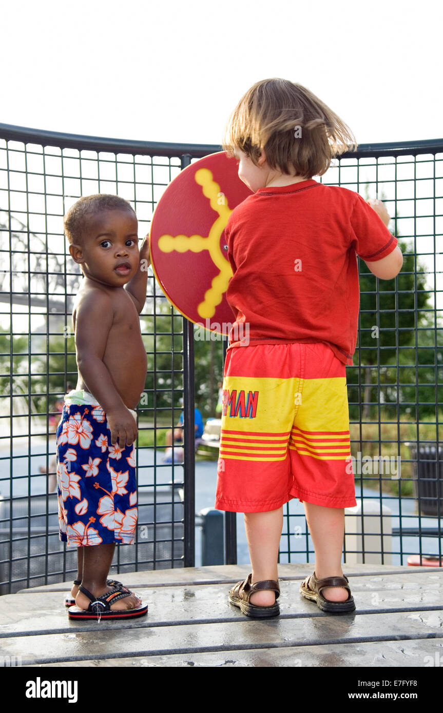 Toddlers Playing on Playground at Waterfront Park in Louisville Kentucky Stock Photo