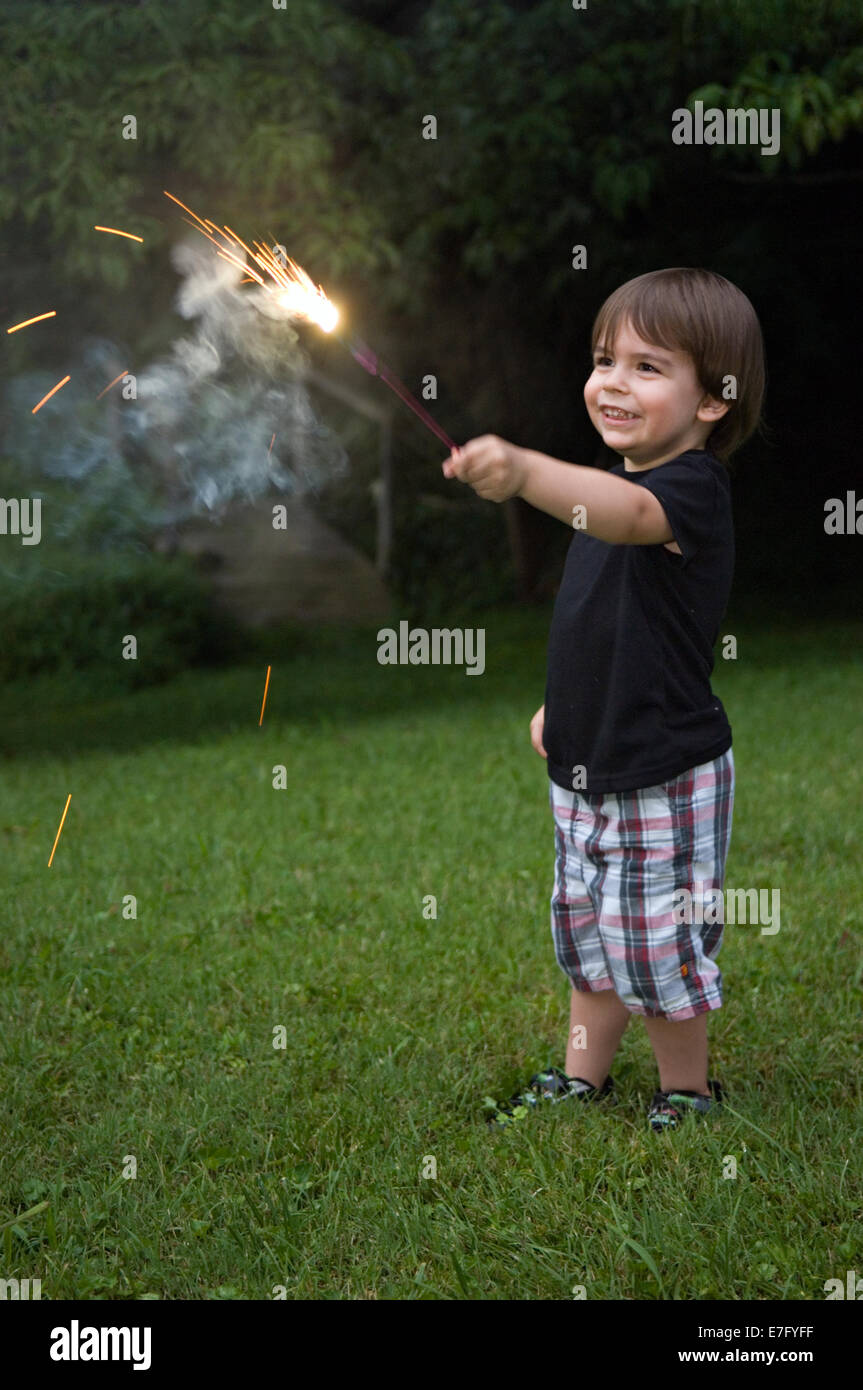 Toddler Playing with Sparkler on Independence Day in Indiana - Stock Image