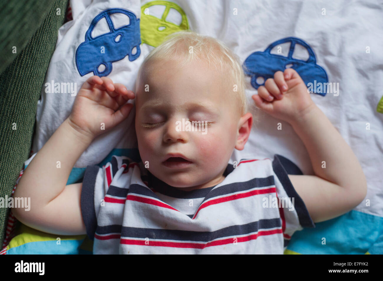 A sleeping child at two years old - Stock Image