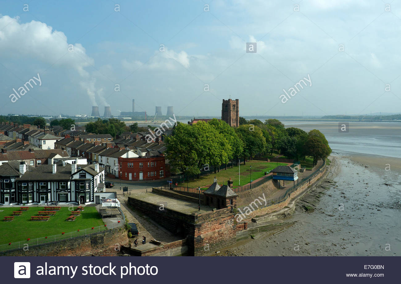 View of West Bank, Widnes, with St.Mary's Church visible and a distant view of Fiddlers Ferry power station. - Stock Image