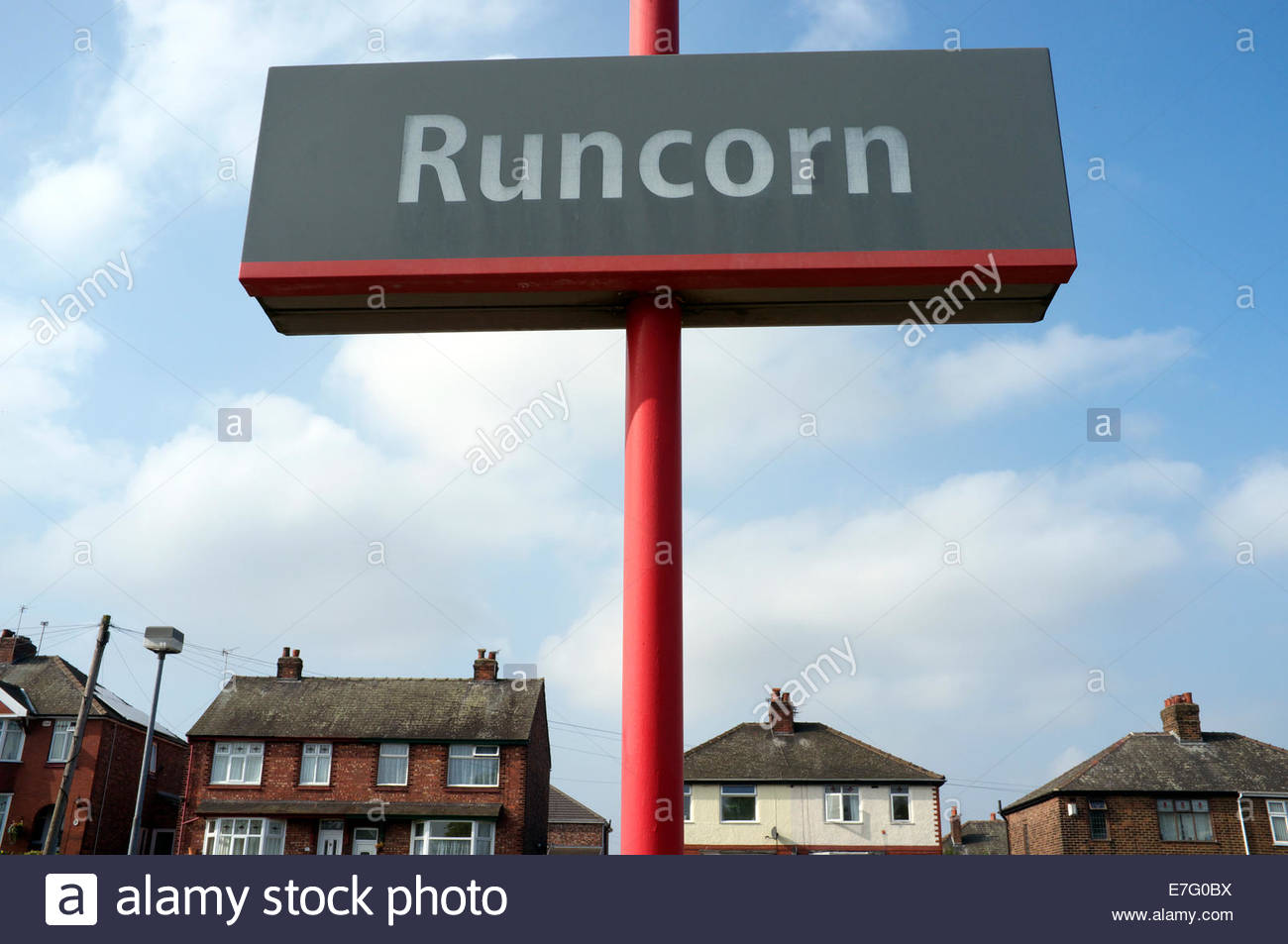 Runcorn - place name location sign at the town's railway station, with residential property in background. Runcorn, - Stock Image