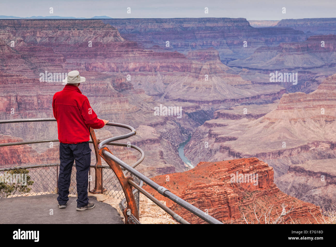 Senior man looking out over Hopi Point, Grand Canyon, Arizona. Focus on foreground. - Stock Image