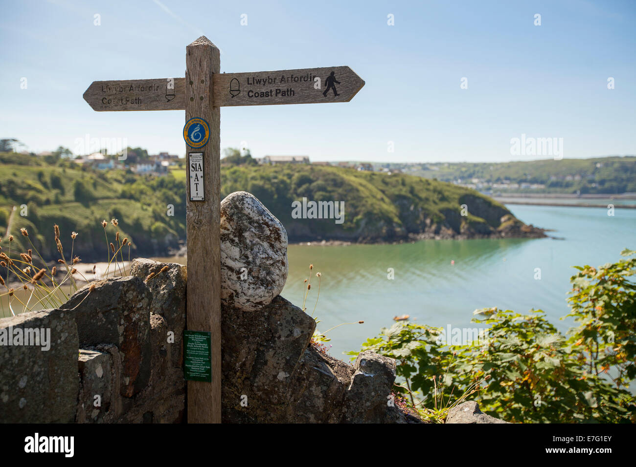 Wooden signpost showing cycling paths in Pembrokeshire, Wales - Stock Image
