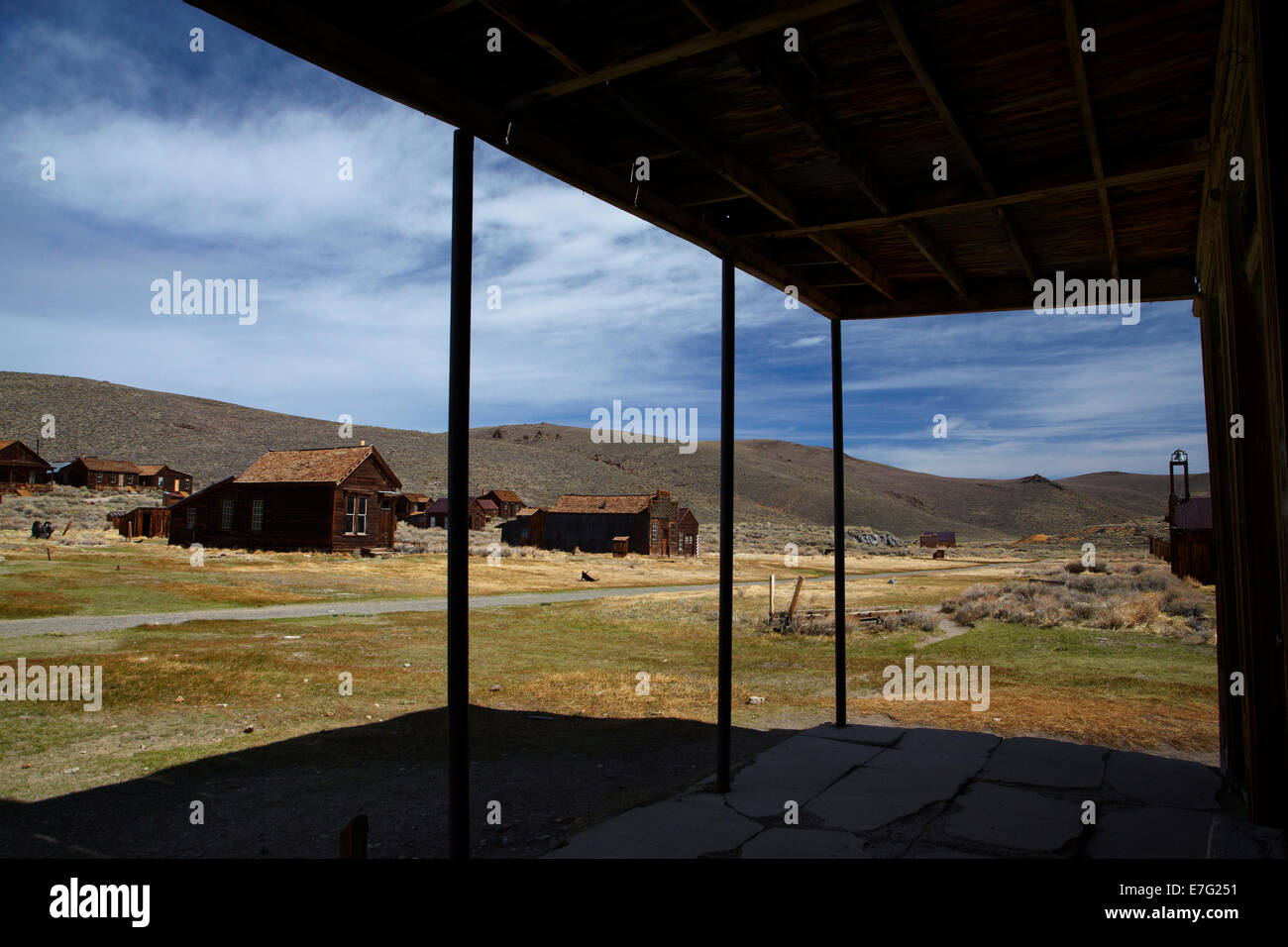 Old buildings seen from under the verandah of the Wheaten and Hollis Hotel, Bodie Ghost Town, Eastern Sierra, California, Stock Photo