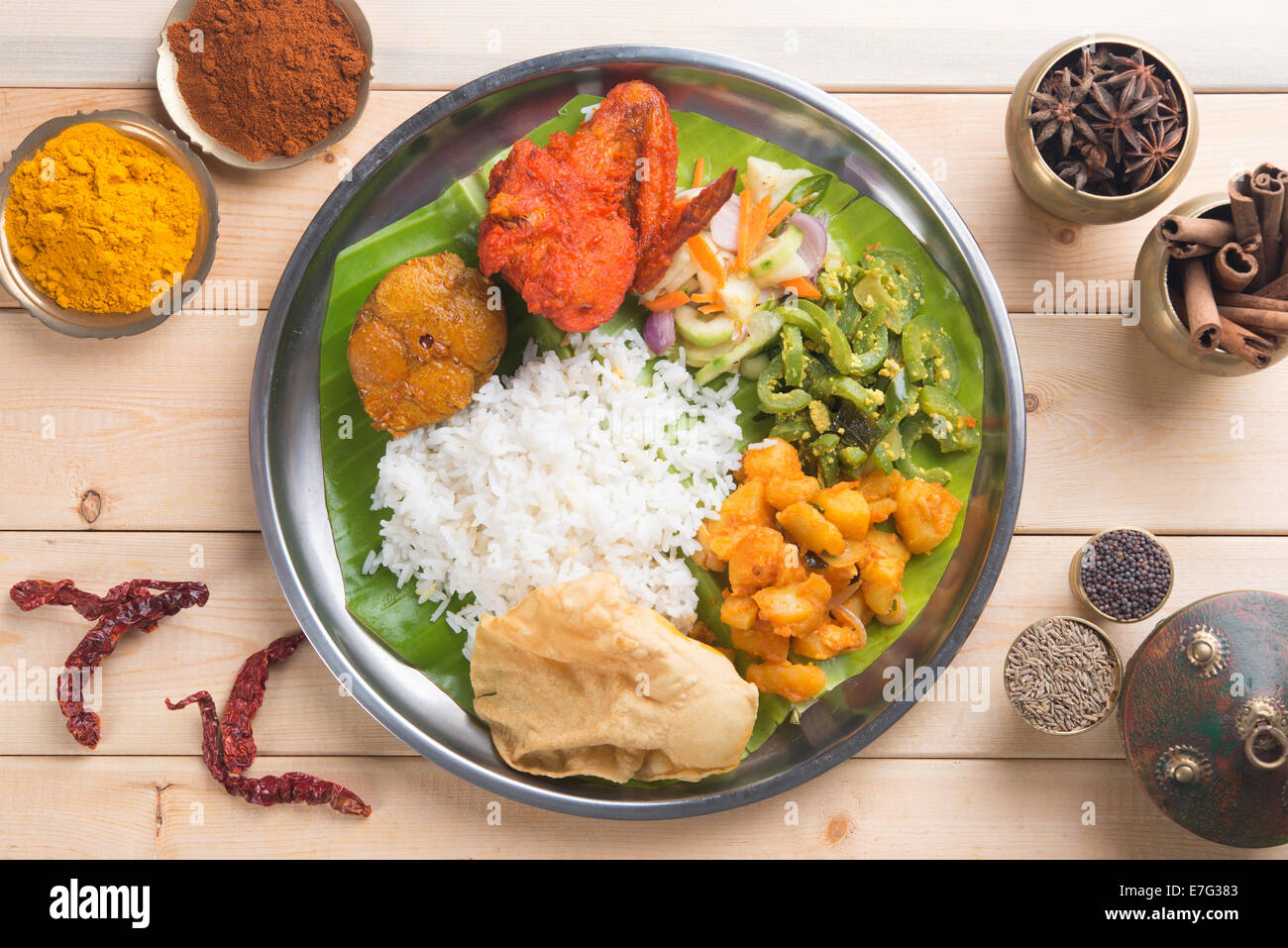 Overhead view of Indian mixed rice on wooden dining table with setting. & Overhead view of Indian mixed rice on wooden dining table with Stock ...