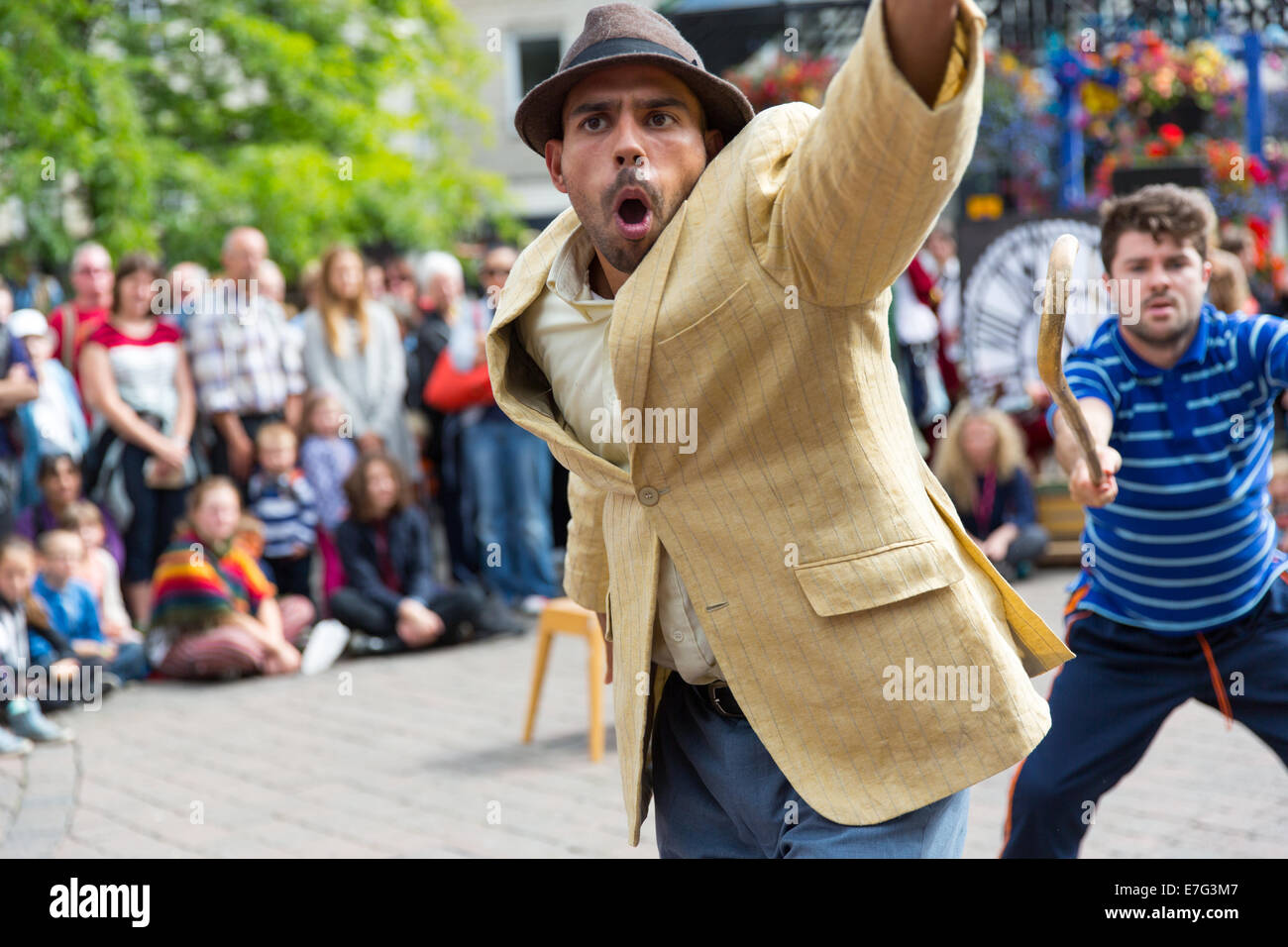 Two street entertainers dancing during Kendal Mintfest 2014 - Stock Image