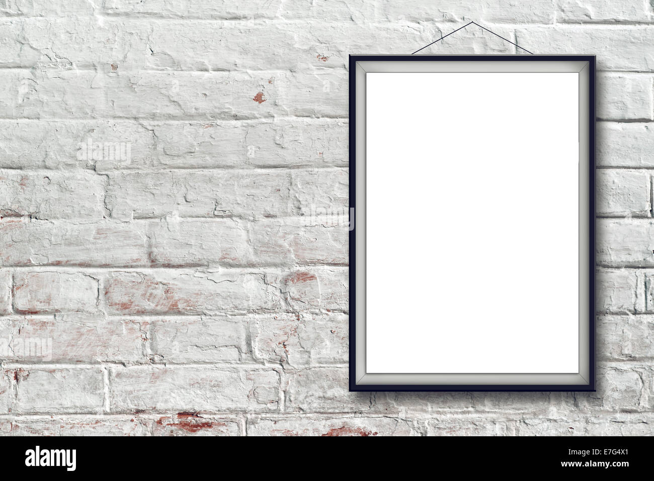 Blank Vertical Painting Poster In Black Frame Hanging On White Brick