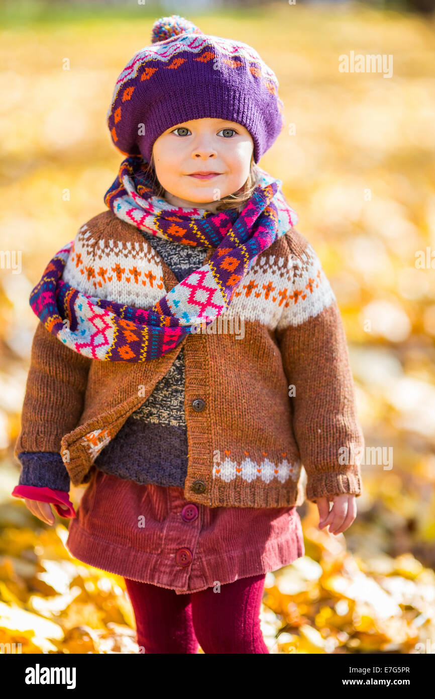 Happy little girl walking in the autumn park - Stock Image