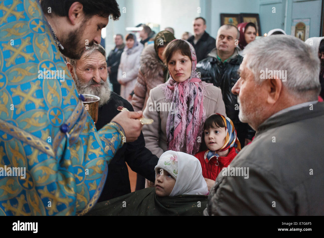 Blessing of the sick at the Feast of Epiphany in the church of the Orthodox Old Believers, Vilkovo, Ukraine - Stock Image