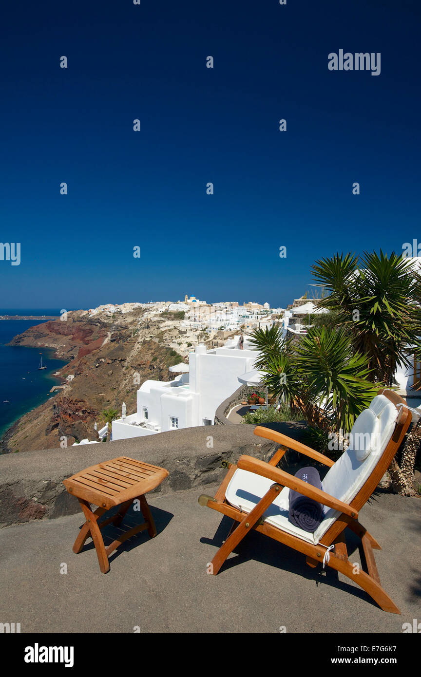 Deck chair on the terrace with sea view, Perivolas Hotel, Oia, Santorini, Cyclades, Greece - Stock Image