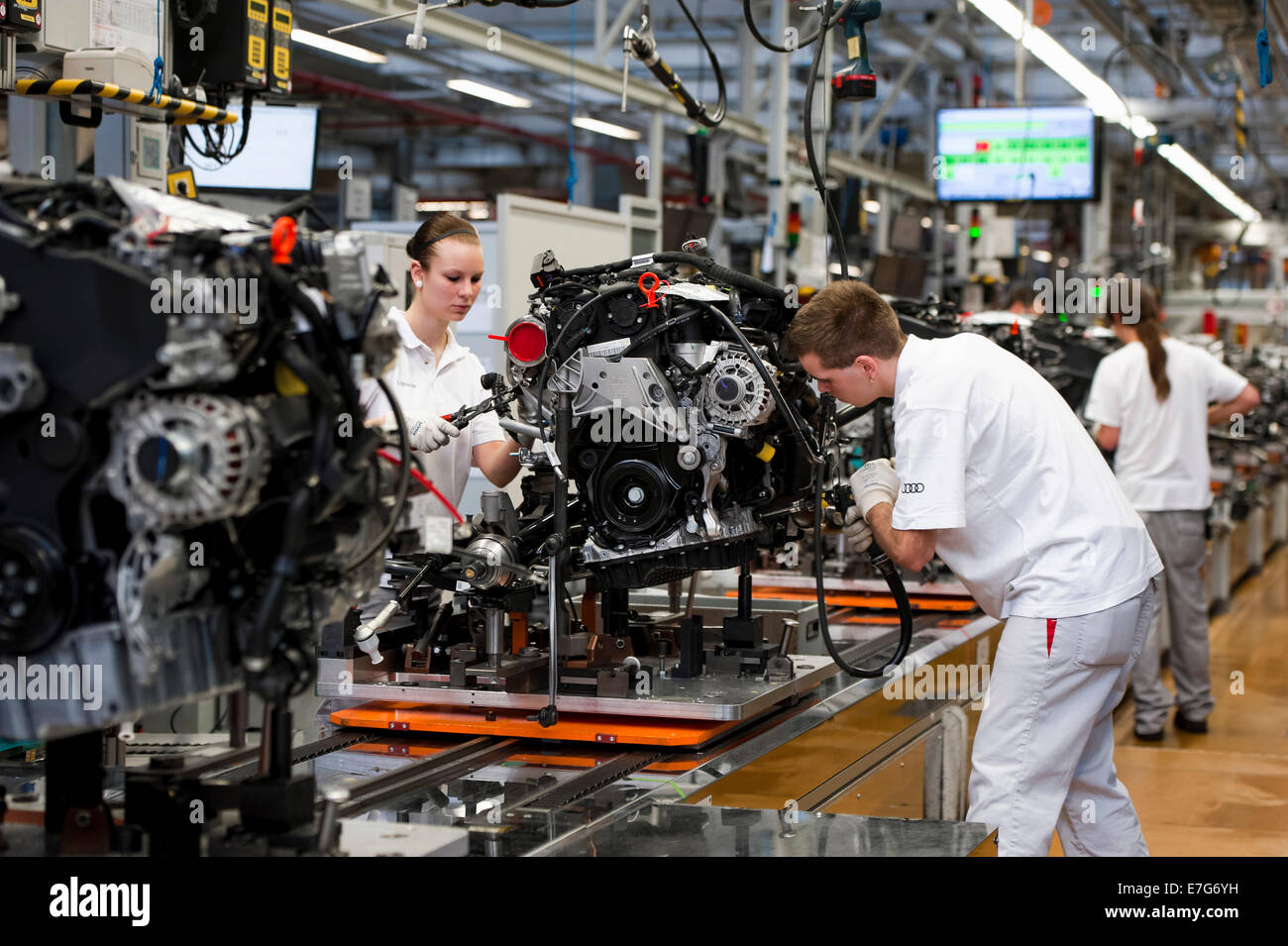 Man working on the production line of the Audi A3 at the Audi plant, Ingolstadt, Bavaria, Germany - Stock Image
