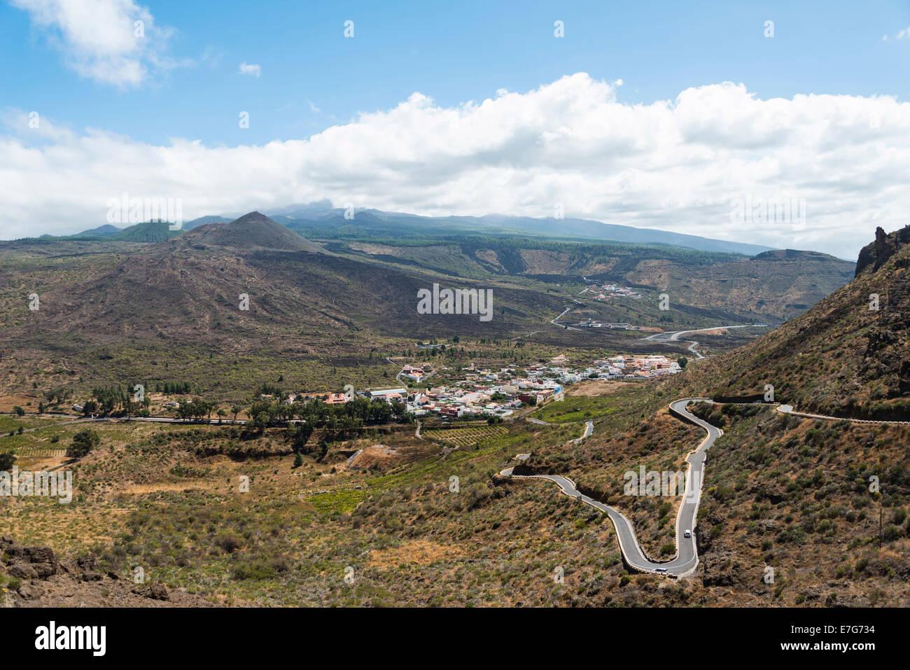 Winding road, volcanic landscape, Santiago del Teide, Tenerife, Canary Islands, Spain - Stock Image