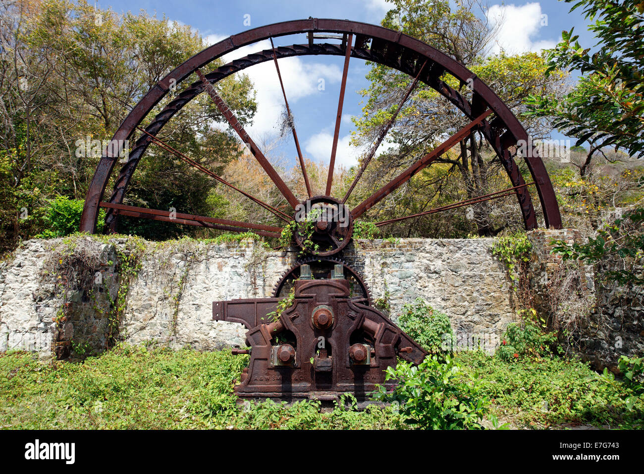 Old sugar cane mill, mill wheel, rusted, Trinidad and Tobago - Stock Image