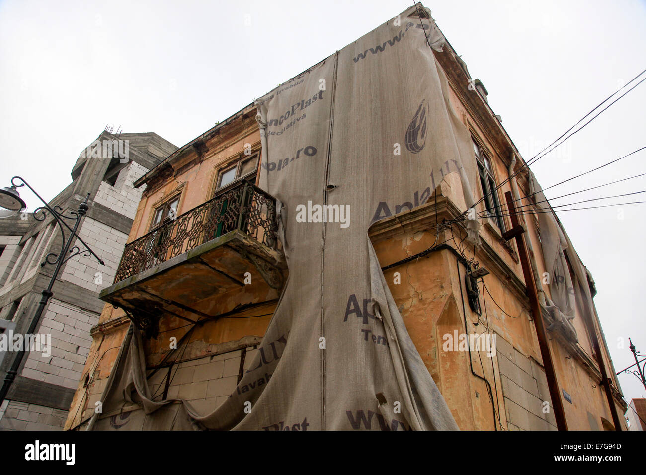 Post communist decay, abandoned building deterioration, Bucharest Romania - Stock Image
