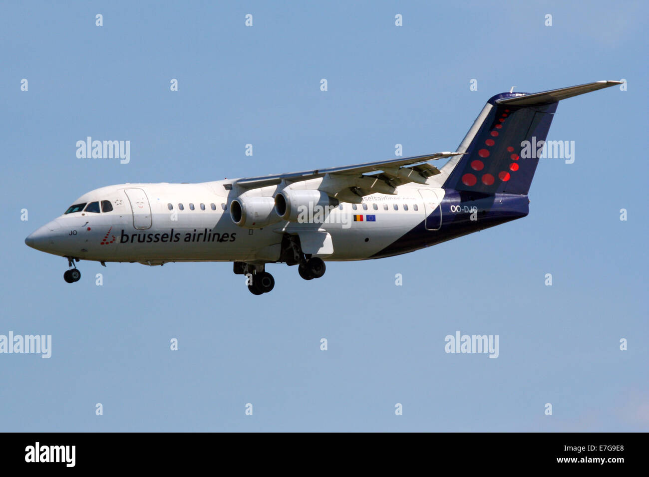 Brussels Airlines British Aerospace Avro RJ85 approaches runway 27L at London Heathrow airport. - Stock Image