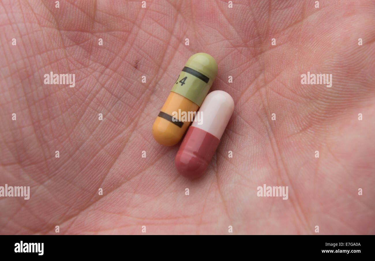 Pills on a human hand, 18 August 2014 in Hamburg. Stock Photo
