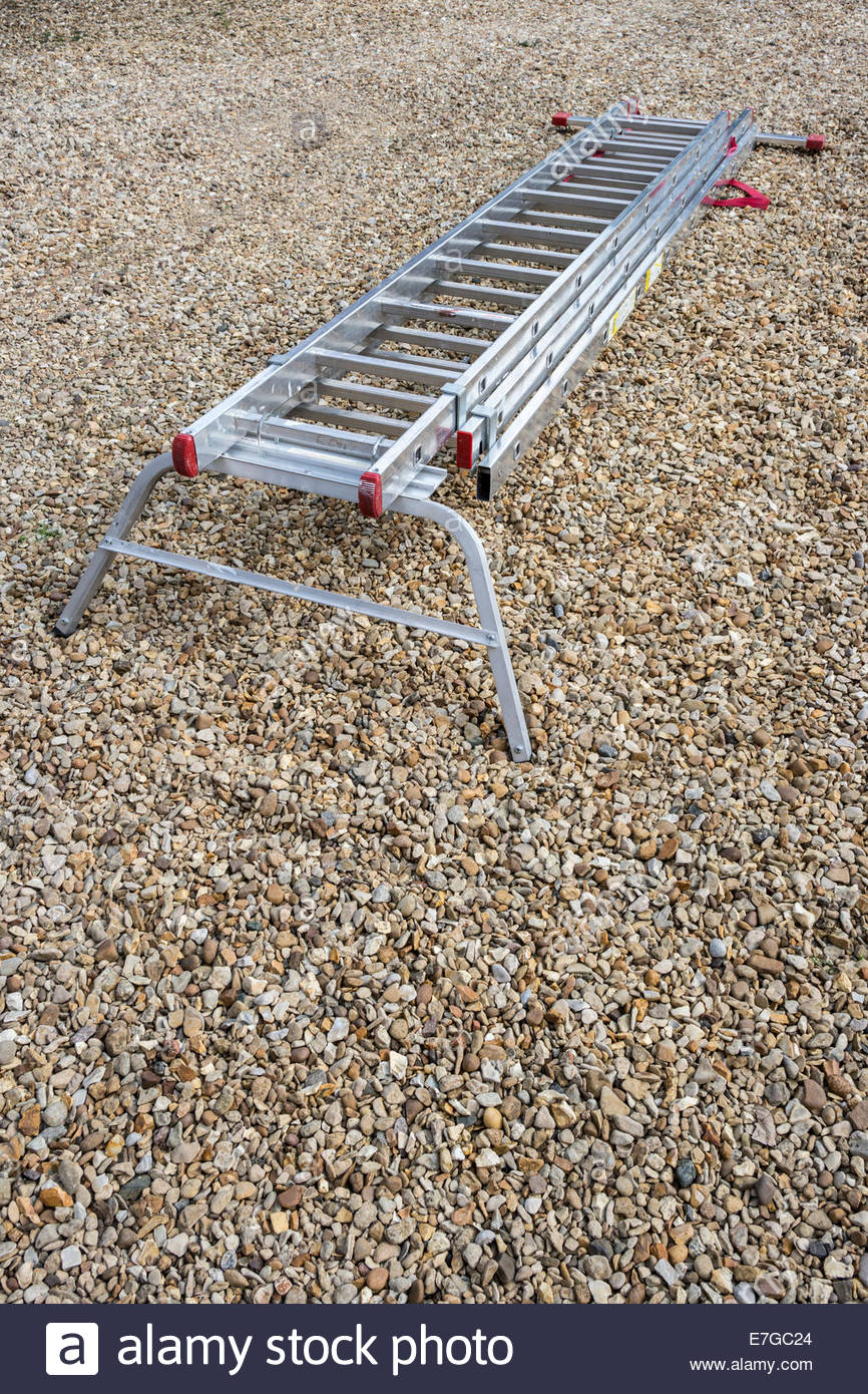 Extending ladder with stand-off attachment - Stock Image