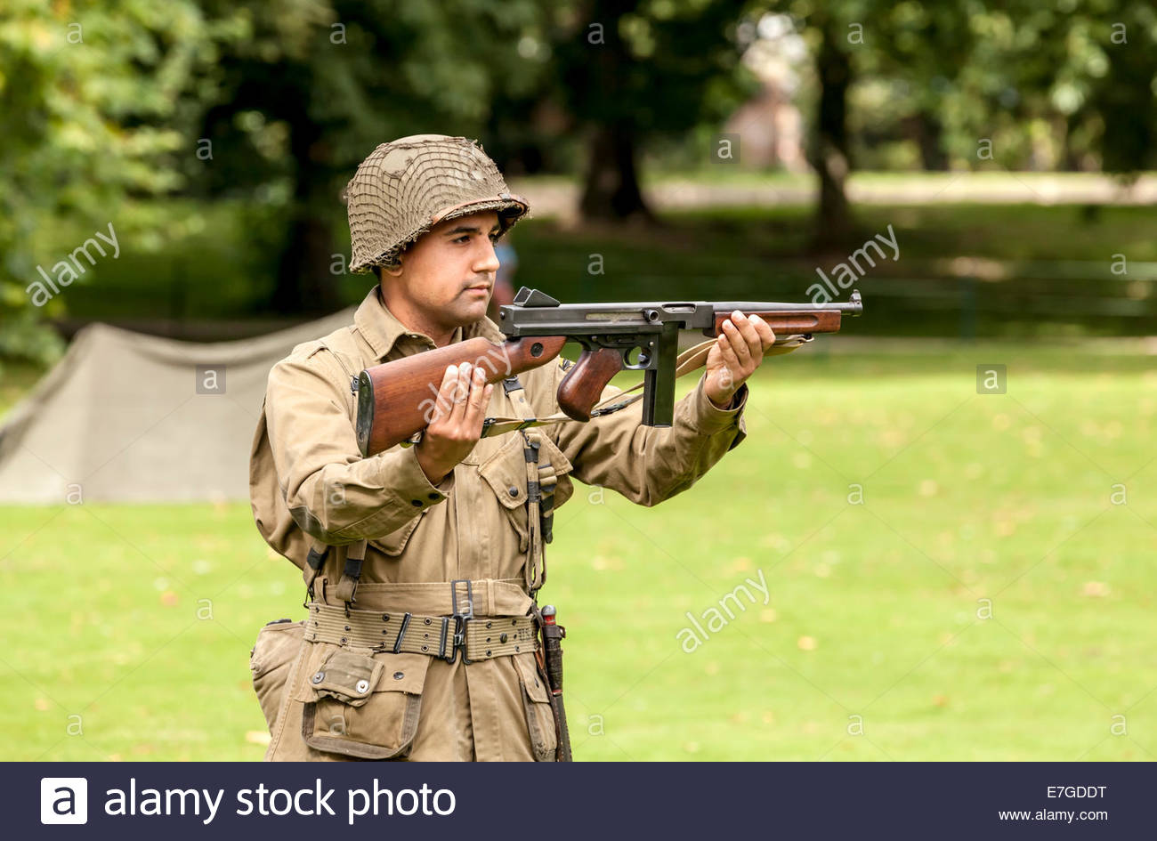 ww2 reenactment american soldier holding a thompson