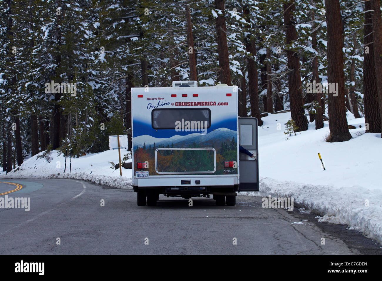 RV and snow at Carson Spur (elevation 7990ft), Carson Pass Highway (SR 88), over Sierra Nevada, California, USA - Stock Image