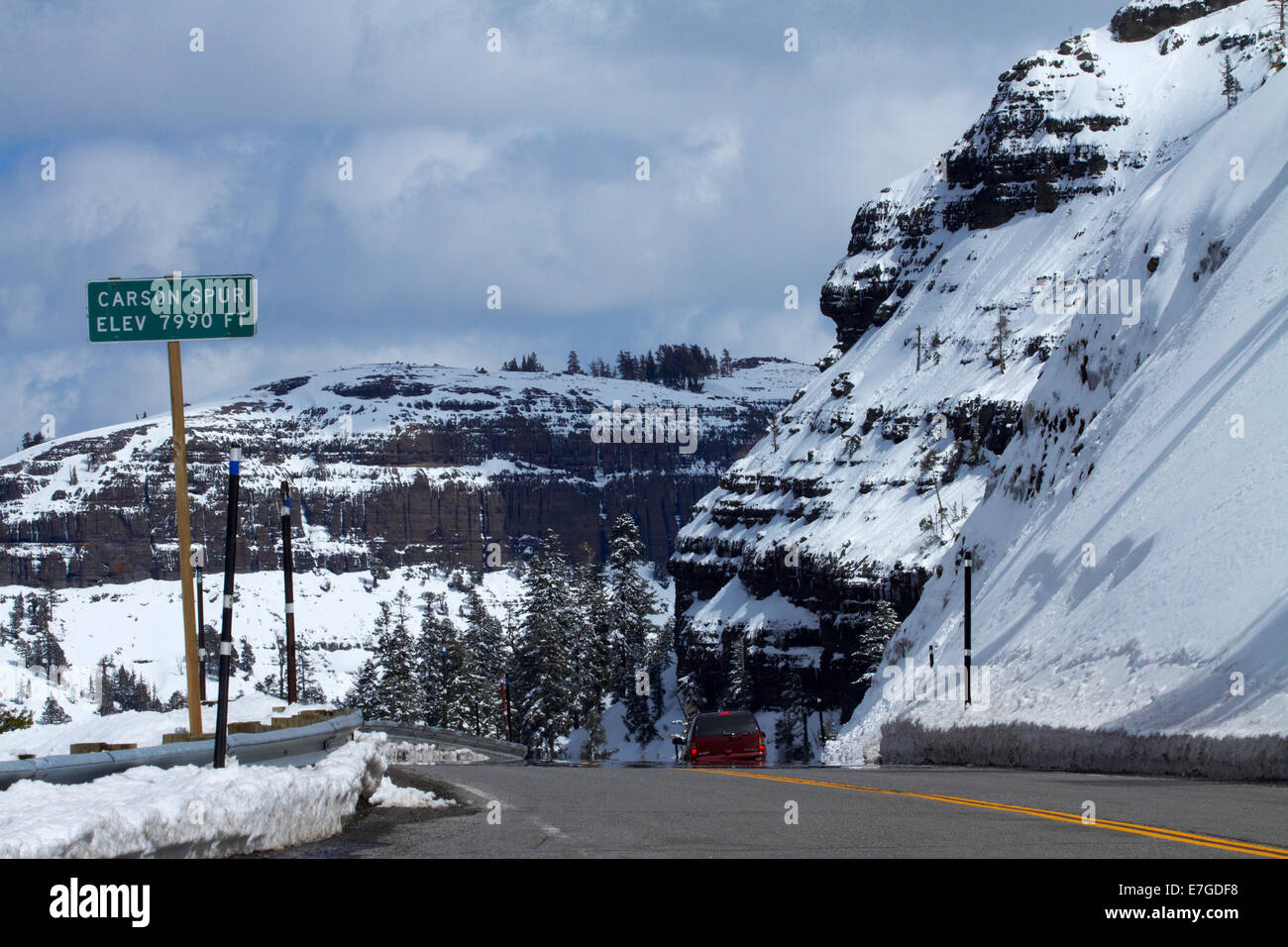 Snow and road at Carson Spur (elevation 7990ft), Carson Pass Highway (SR 88), over Sierra Nevada, California, USA - Stock Image
