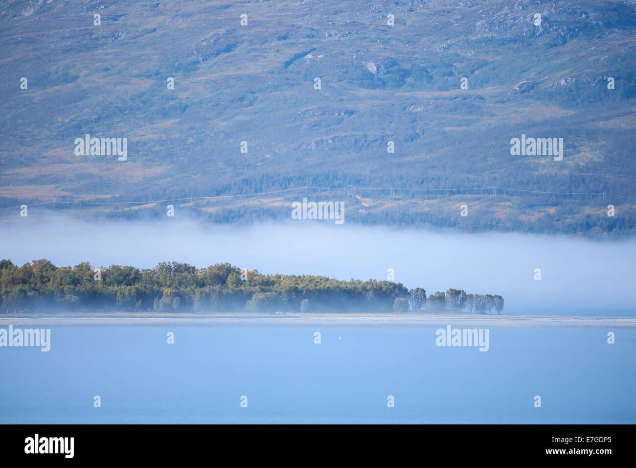 mist over island Grindoya Stock Photo