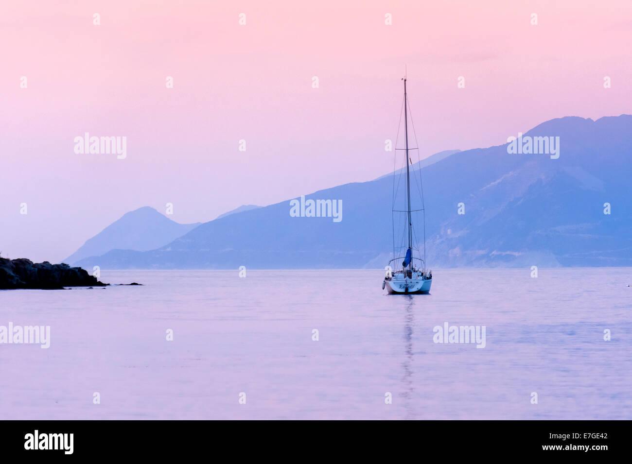 Europe, France, Corsica, Haute Corse, Cap Corse. Saint Florent. Anchored boat at dusk. - Stock Image