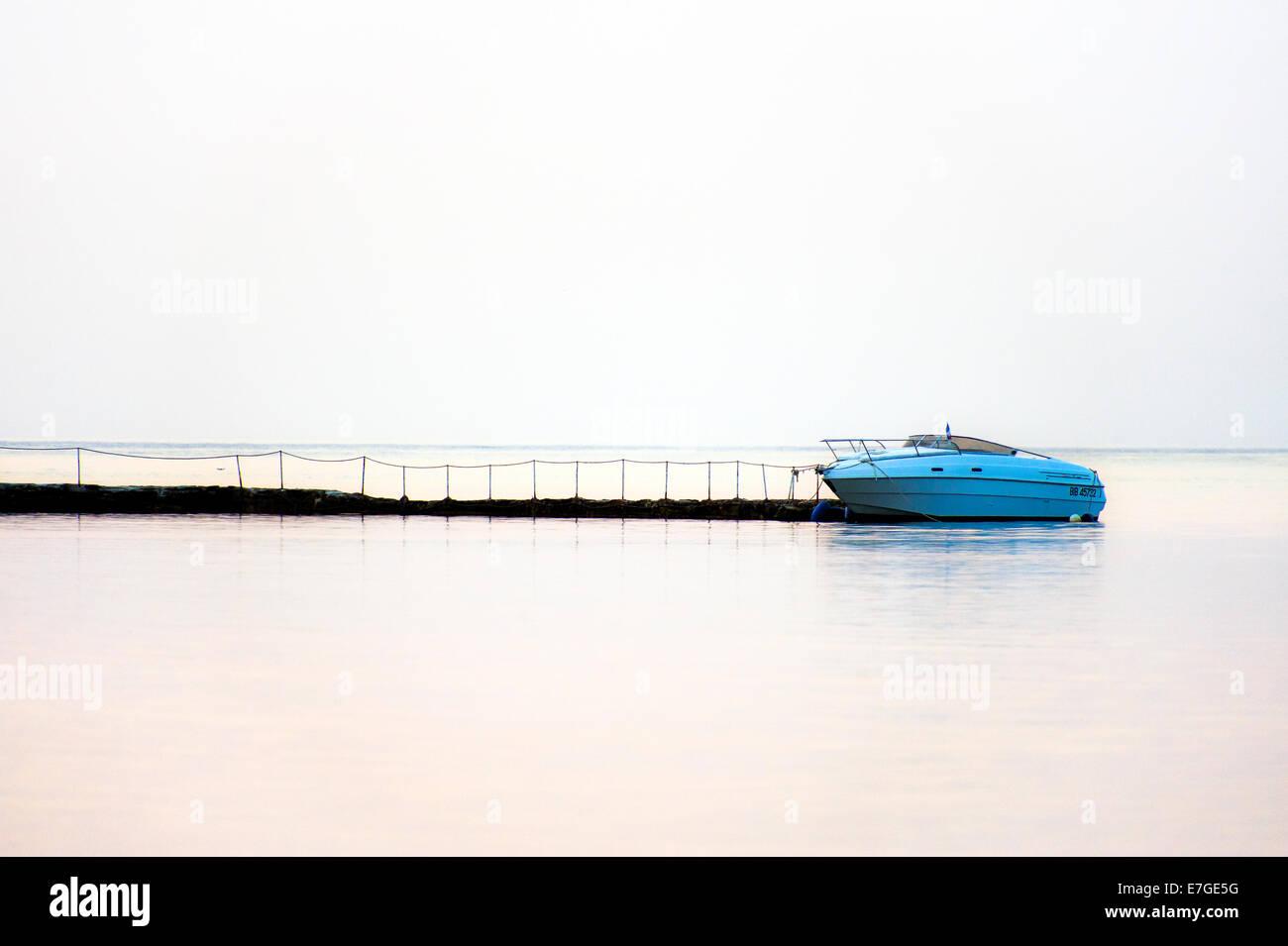 Europe, France, Corsica, Haute Corse, Cap Corse. Saint Florent. Anchored boat. - Stock Image