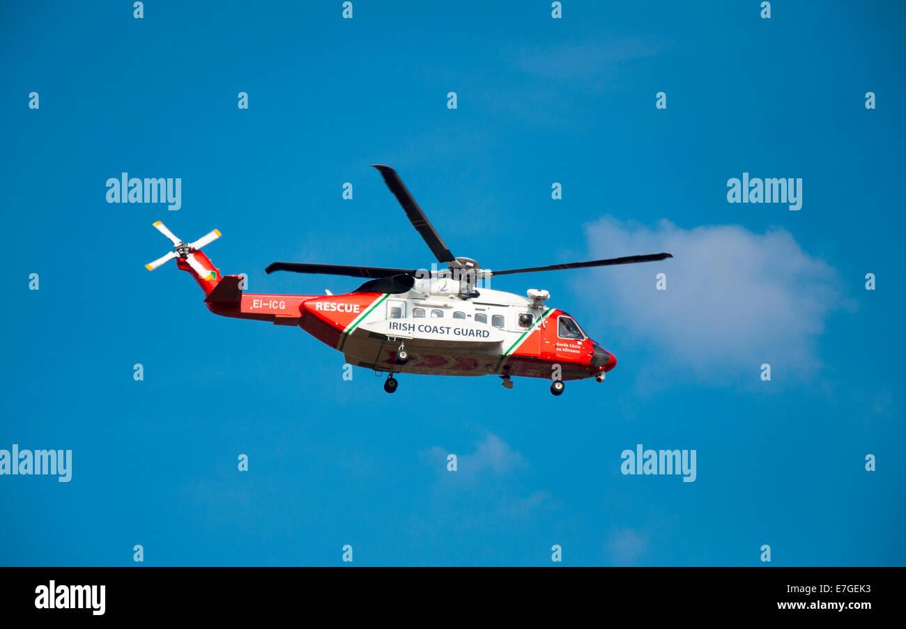 Irish Coast Guard IRCG  Garda Cósta na hÉireann Sikorsky helicopter flies above during a medical rescue in rural Stock Photo