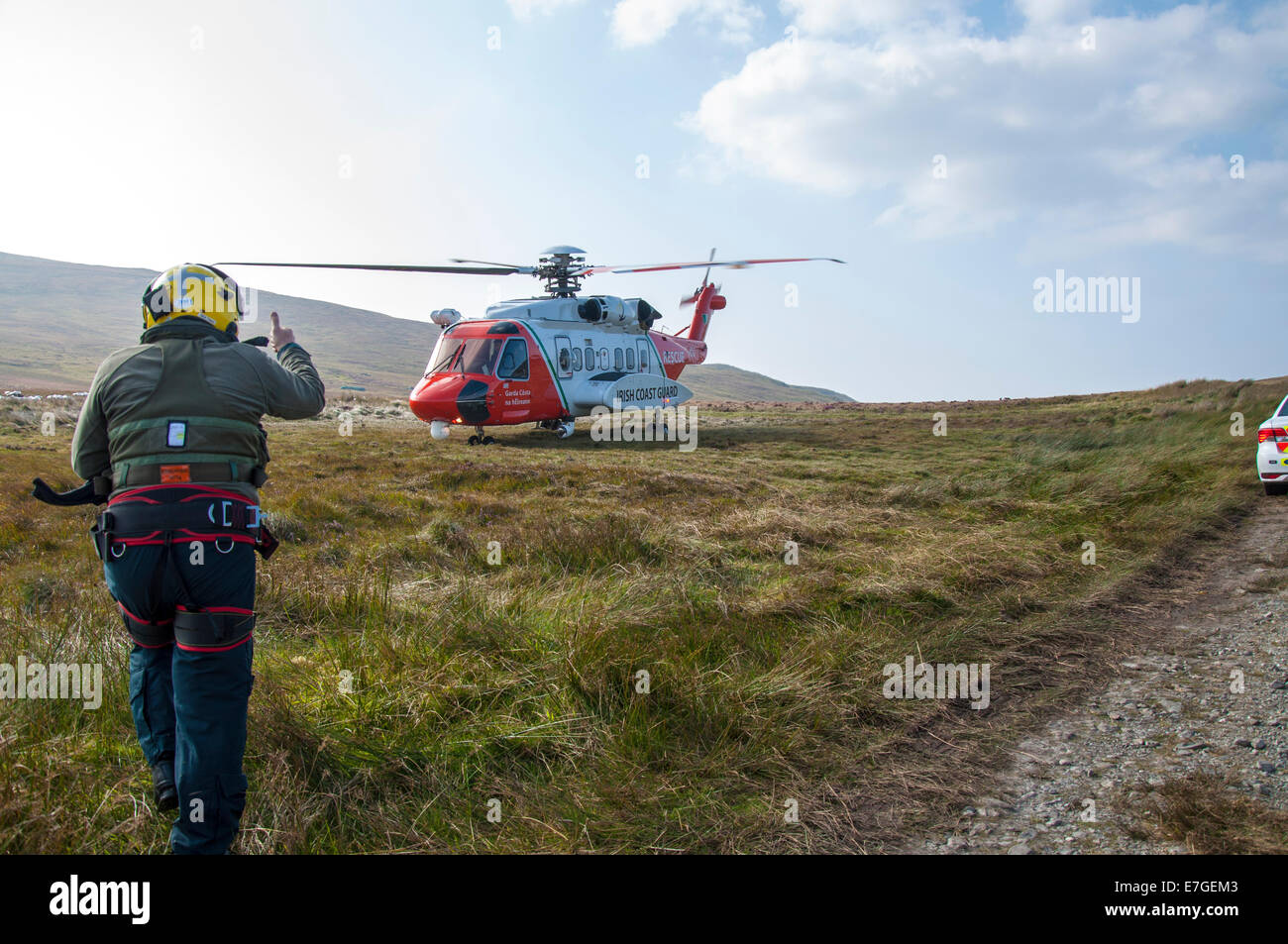 Irish Coast Guard IRCG  Garda Cósta na hÉireann Sikorsky helicopter lands on the bog during a medical rescue in Stock Photo