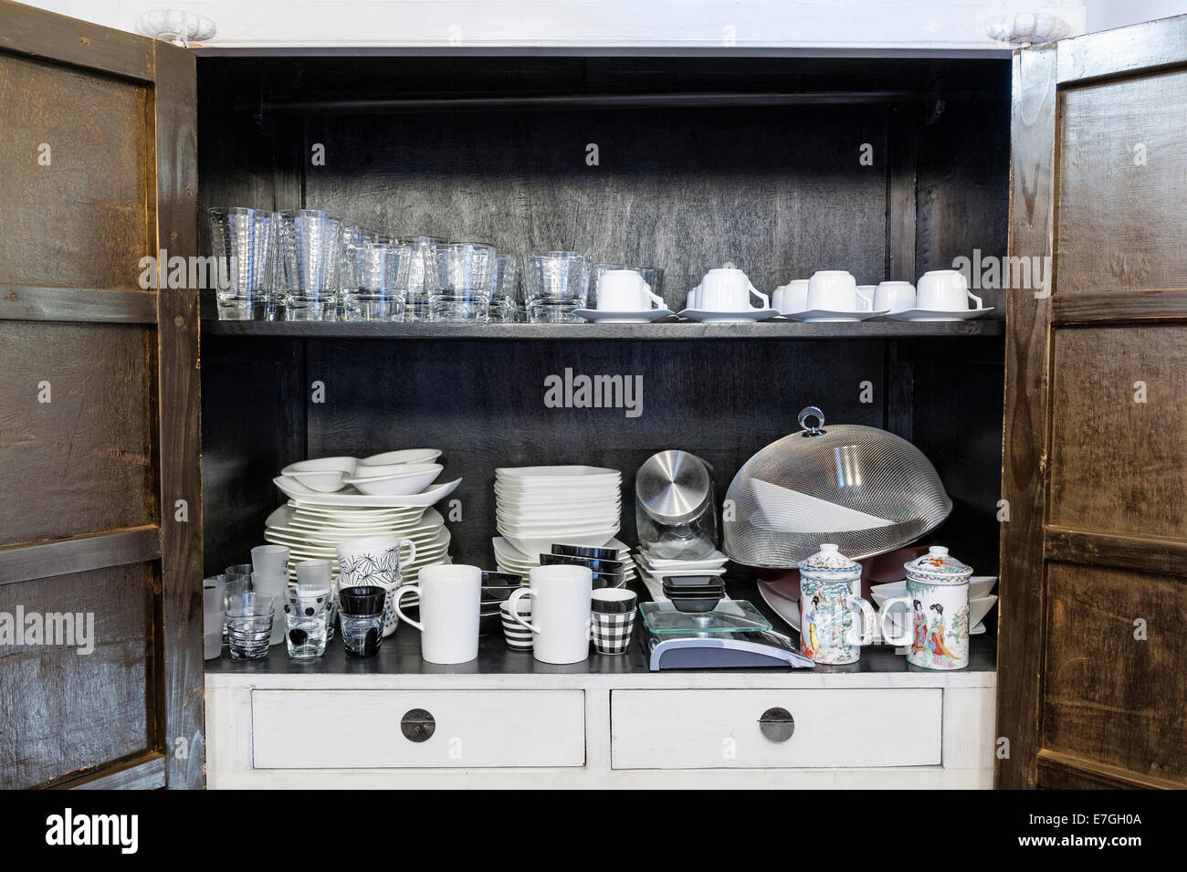 kitchen cabinet with traditional utensils and tools - Stock Image