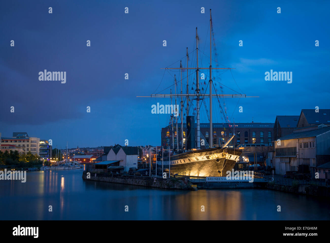 Twilight over Brunel's SS Great Britain - worlds first steam-powered passenger liner, now a museum in dry dock, - Stock Image