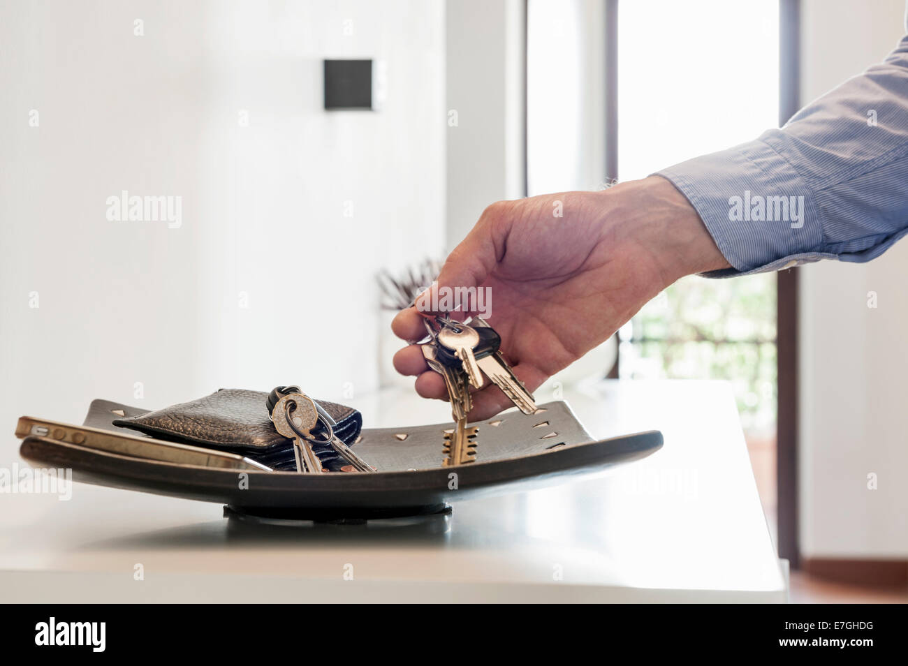 man catch the keys from the personal tray Stock Photo