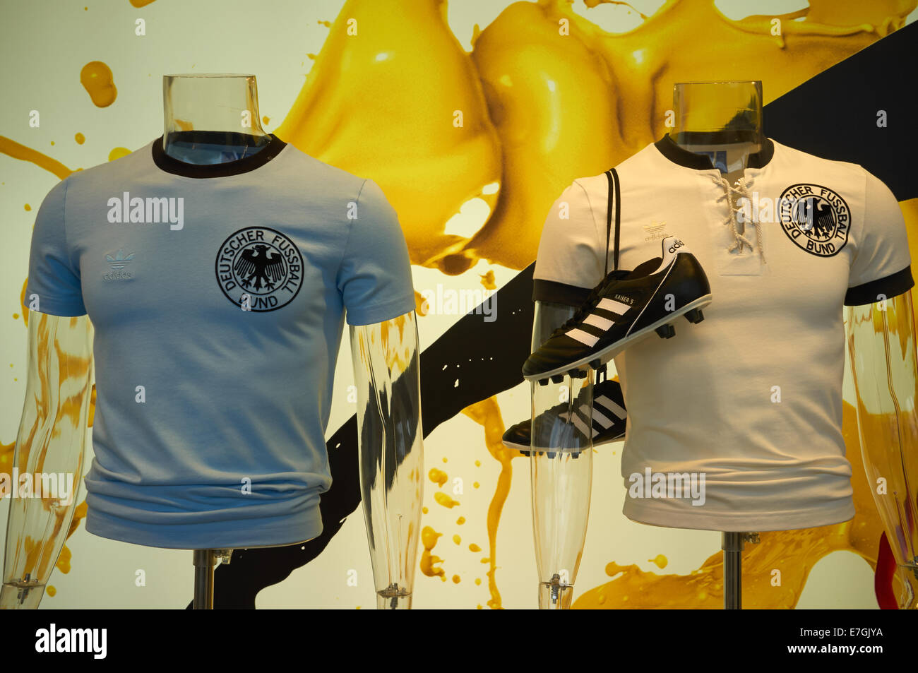 Retro German football shirts on sale in a department store during the 2014 World Cup which Germany won - Stock Image