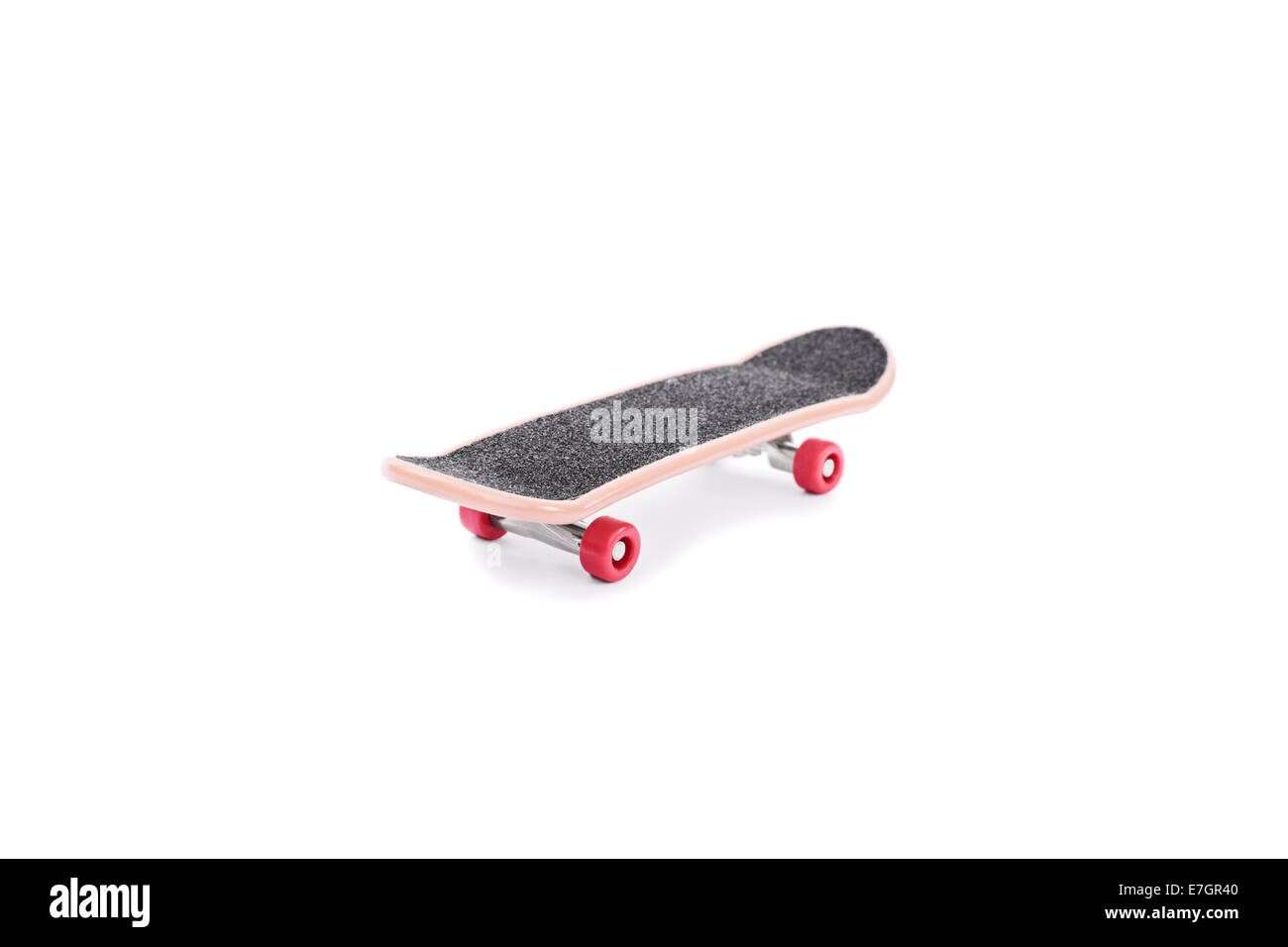 Close-up shot of a toy skate isolated on white background - Stock Image