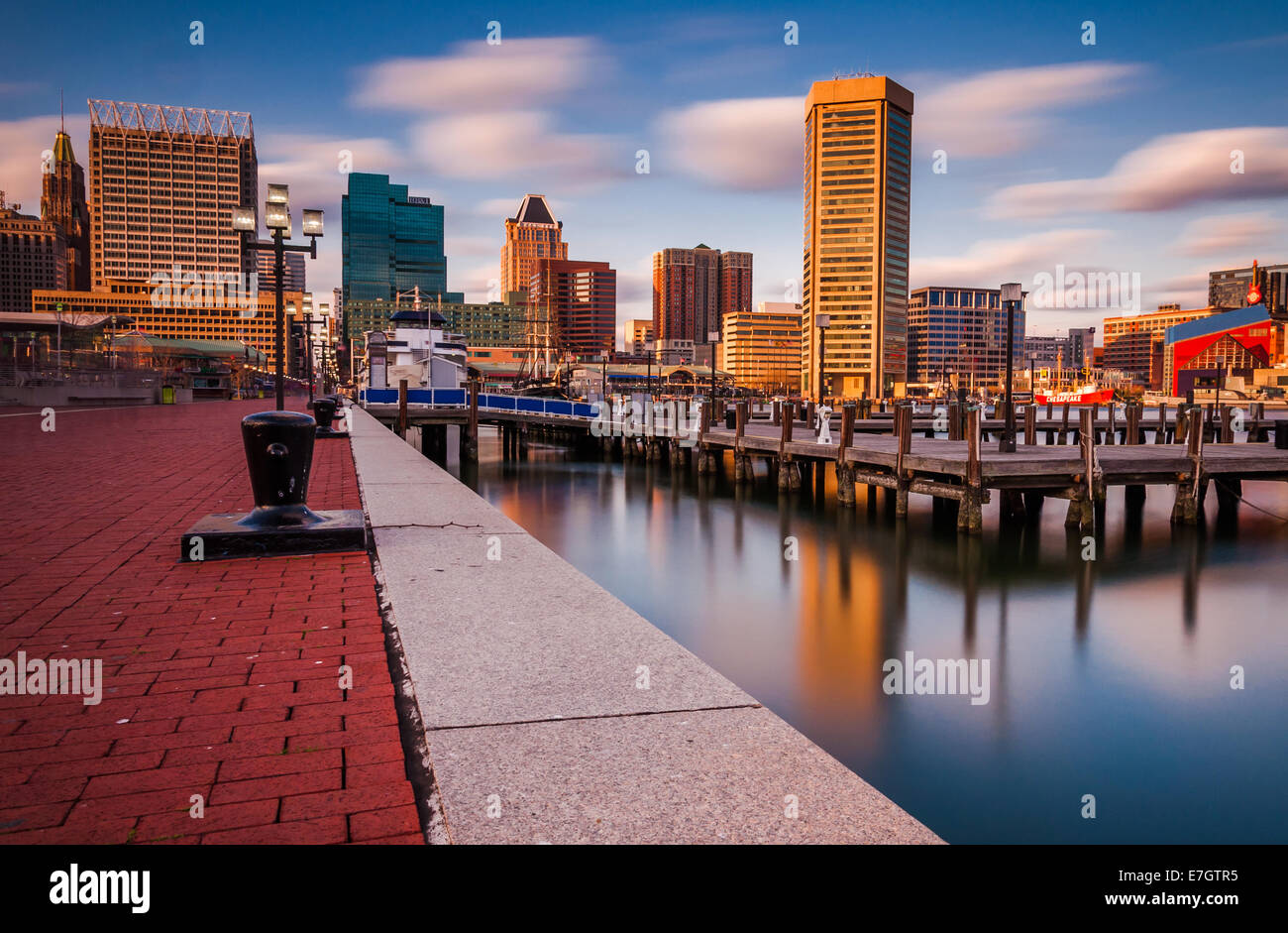 Long exposure of the Baltimore Skyline and Inner Harbor Promenade, Baltimore, Maryland - Stock Image