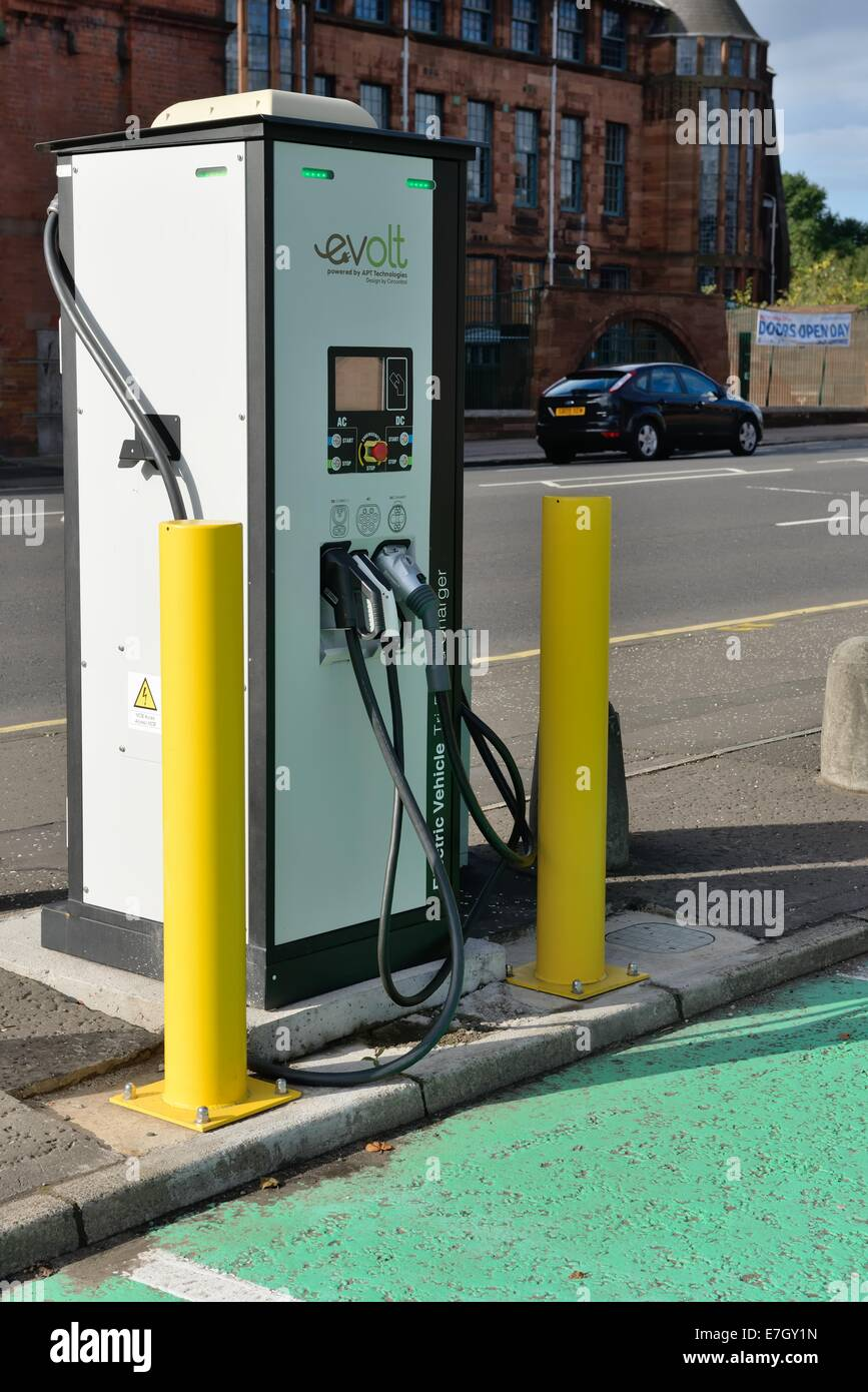 Electric charging point for electric powered cars in car park - Stock Image