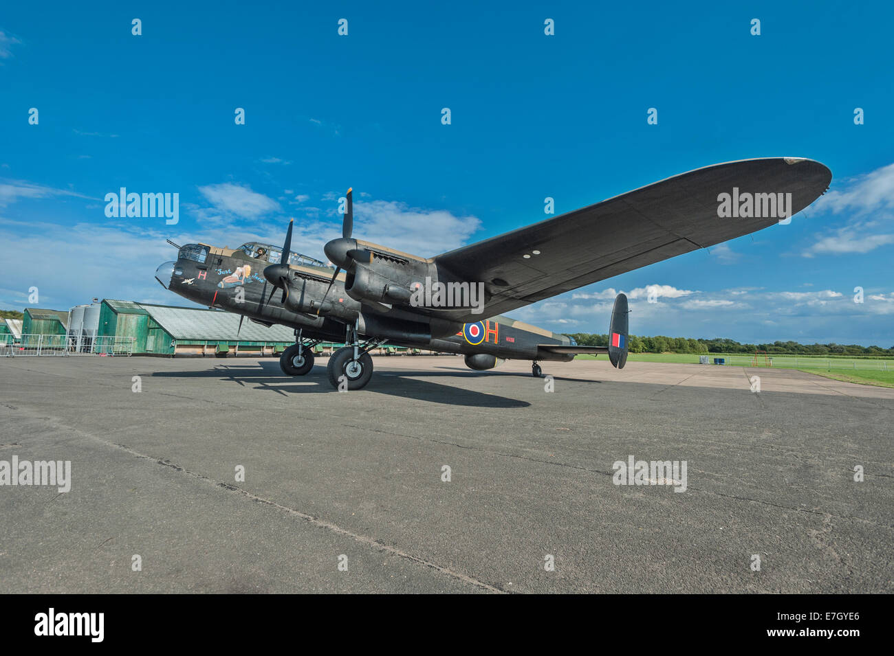 A restored Lancaster bomber 'Just Jane' taxiing at East Kirkby airfield, Lincolnshire. Space for text in - Stock Image