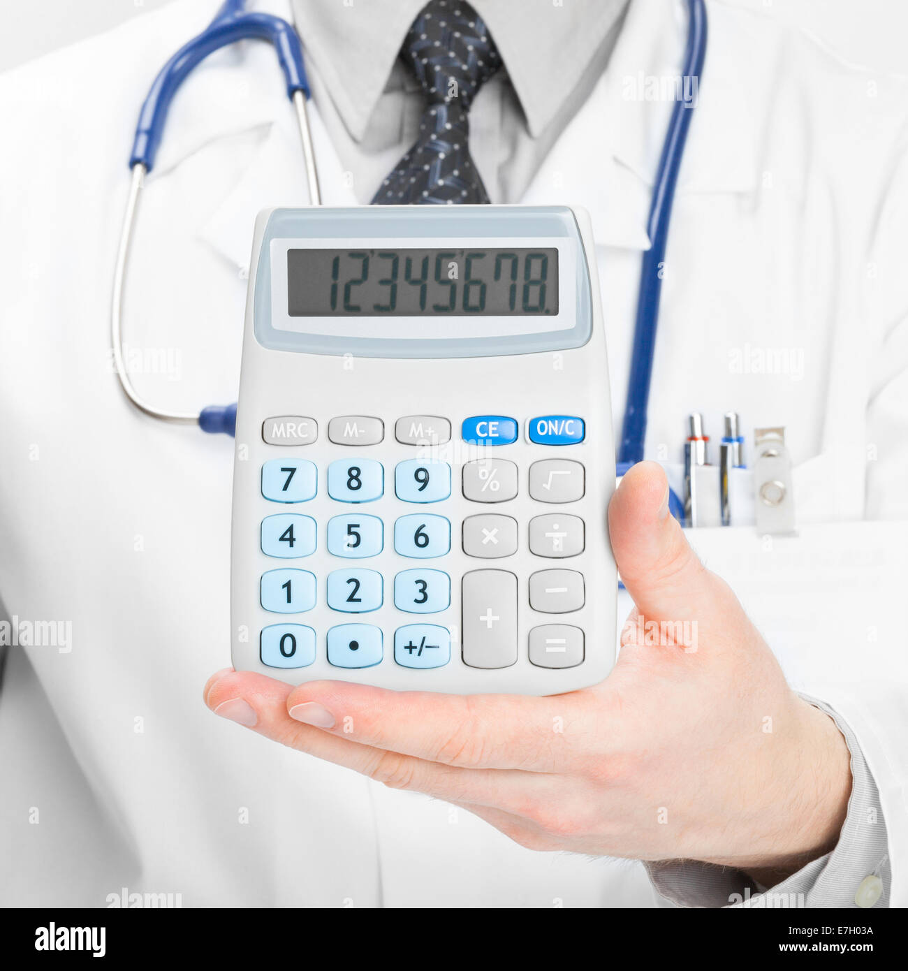 Medical doctor with calculator in his hand - heath care concept - 1 to 1 ratio Stock Photo