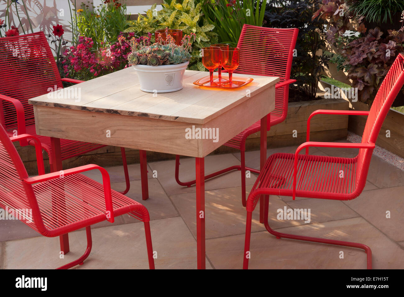 Garden - The Narrows - patio with table and red chairs plant pot with sempervivum - Designer - Pip Probert - Stock Photo