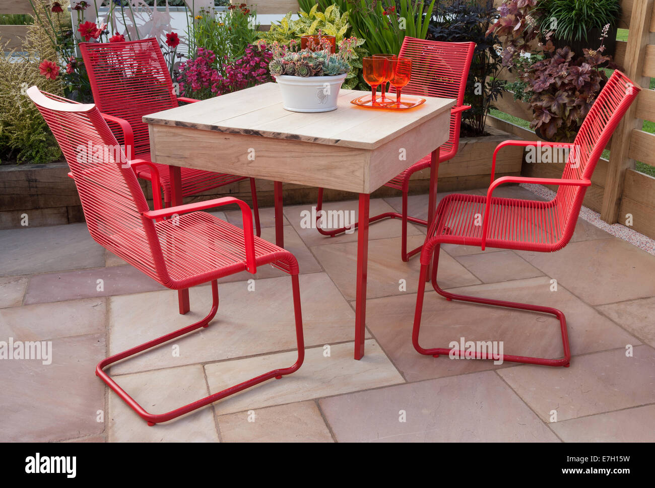 Garden - The Narrows - patio with table and red chairs plant pot with sempervivum - Designer - Pip Probert - - Stock Image