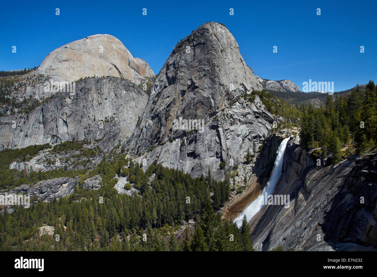Nevada Fall, and the granite dome of Liberty Cap, on The Mist Trail, Yosemite National Park, California, USA Stock Photo